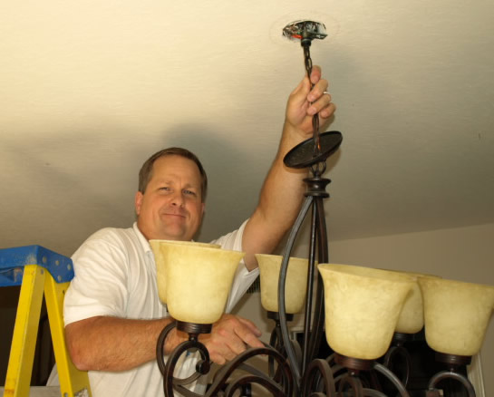 Lighting Conejo Valley Electrical Contractor Installing Chandelier